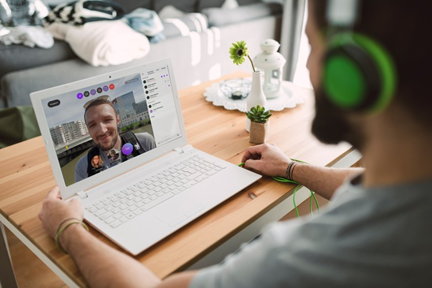 Man video chatting on his laptop with another individual